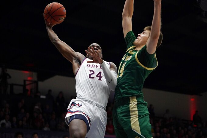 Saint Mary's forward Malik Fitts (24) scores in the first half against Cal Poly forward Tuukka Jaakkola (14) during an NCAA college basketball game on Sunday, Nov. 17, 2019, in Moraga, Calif. (AP Photo/Don Feria)