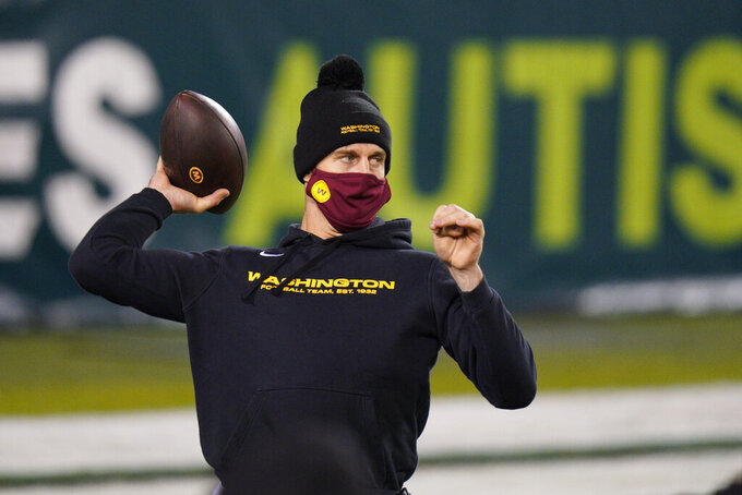 Washington Football Team's Alex Smith warms up before an NFL football game against the Philadelphia Eagles, Sunday, Jan. 3, 2021, in Philadelphia. (AP Photo/Chris Szagola)