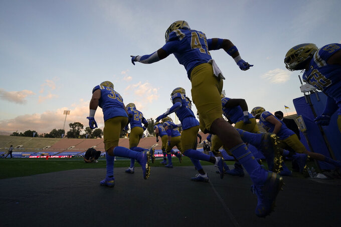 UCLA enters the Rose Bowl before an NCAA college football game against Southern California, Saturday, Dec 12, 2020, in Pasadena, Calif. (AP Photo/Ashley Landis)