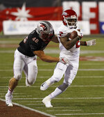 UNLV linebacker Bailey Laolagi (48) pulls Fresno State wide receiver Michiah Quick out of bounds during the second half of an NCAA college football game Saturday, Nov. 3, 2018, in Las Vegas. (AP Photo/John Locher)