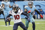 Houston Texans wide receiver DeAndre Hopkins (10) carries the ball ahead of Tennessee Titans strong safety Kenny Vaccaro (24) in the second half of an NFL football game Sunday, Dec. 15, 2019, in Nashville, Tenn. (AP Photo/James Kenney)