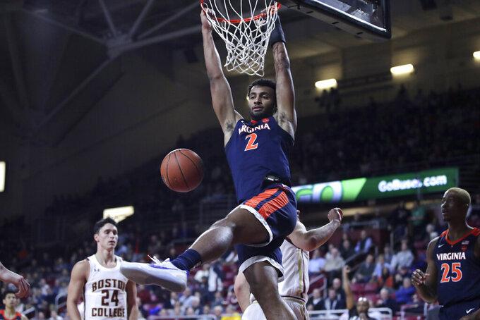 Virginia guard Braxton Key (2) slams a dunk against Boston College during the first half of an NCAA college basketball game Tuesday, Jan. 7, 2020 in Boston. (AP Photo/Charles Krupa)