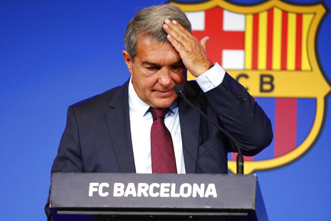 FC Barcelona club President Joan Laporta begins a news conference in Barcelona, Spain, Friday, Aug. 6, 2021. Barcelona's announcement that Lionel Messi would be leaving the club set Paris Saint-Germain scrambling to figure out if it could sign the most desired free agent in soccer history. (AP Photo/Joan Monfort)