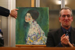 The painting which was found last December near an art gallery and believed to be the missing Gustav Klimt's painting 'Portrait of a Lady' is displayed during a press conference in Piacenza, Italy, Friday, Jan. 17, 2020. Art experts have confirmed that a stolen painting discovered hidden inside an Italian art gallery's walls is Gustav Klimt's
