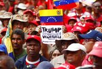 Members of the Bolivarian militia attend a protest against U.S. sanctions on Venezuela, in Caracas, Venezuela, Wednesday, Aug. 7, 2019. U.S. President Donald Trump signed an executive order Monday freezing Venezuelan government assets in the United States, allowing the Treasury Department to sanction any person, business or other entity assisting the administration of President Nicolas Maduro. (AP Photo/Leonardo Fernandez)