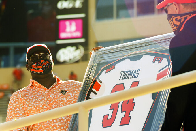 Hall of Fame running back Thurman Thomas is honored as the first inductee into the Oklahoma State football Ring of Honor at half time of an NCAA college football game against West Virginia Saturday, Sept. 26, 2020, in Stillwater, Okla. (AP Photo/Brody Schmidt)