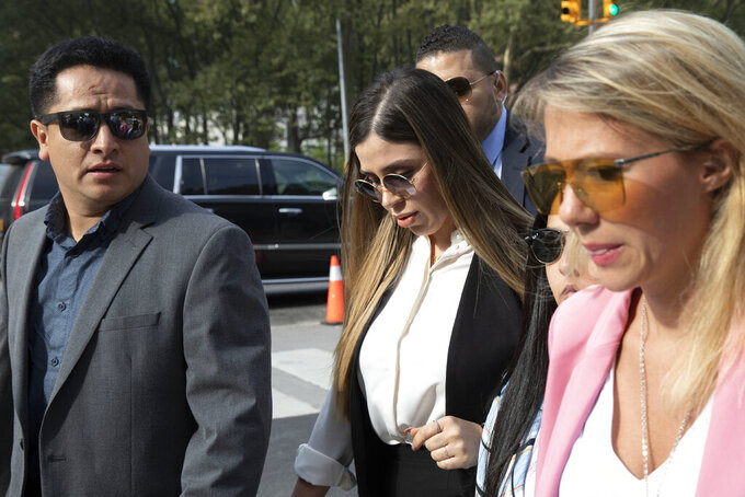 """FILE - In this July 17, 2019 file photo, Emma Coronel Aispuro, center, wife of Mexican drug lord Joaquin """"El Chapo"""" Guzman, arrives for his sentencing at Brooklyn federal court, in New York. Emma Coronel Aispuro is expected to plead guilty to federal criminal charges after she had been charged in the U.S. with helping her husband run his multibillion-dollar criminal empire. She is due in court Thursday, June 10, 2021, in Washington for a plea agreement hearing, according to court records. (AP Photo/Mark Lennihan, File)"""