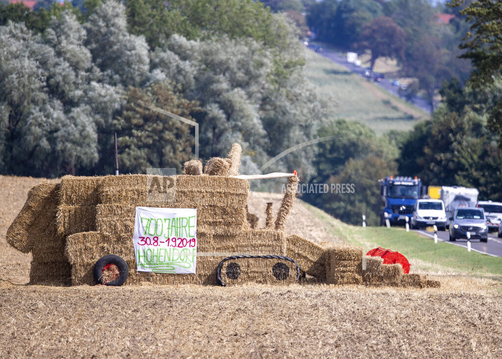 Straw combine advertises village festival
