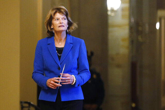 Sen. Lisa Murkowski, R-Alaska, returns to the Senate chamber after a meeting in the Majority Leaders office during a break in the impeachment trial of President Donald Trump at the U.S. Capitol Friday Jan 31, 2020, in Washington. (AP Photo/Steve Helber)