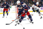 Edmonton Oilers' Joel Persson, top, of Sweden, knocks the puck away from Columbus Blue Jackets' Cam Atkinson during the second period of an NHL hockey game Wednesday, Oct. 30, 2019, in Columbus, Ohio. (AP Photo/Jay LaPrete)