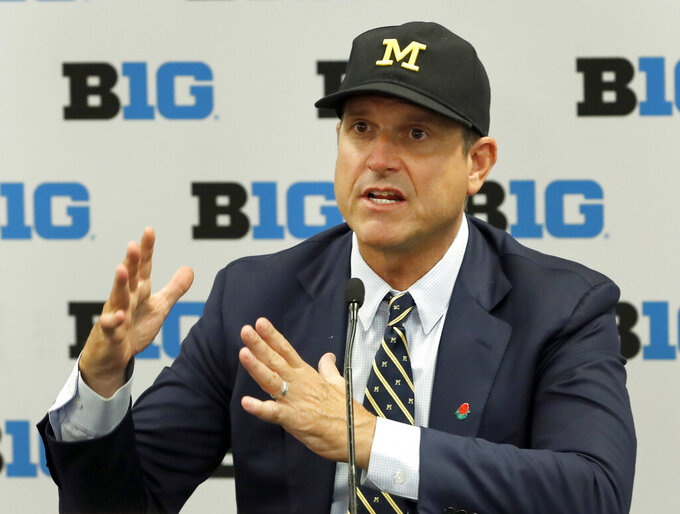 FILE - In this July 19, 2019, file photo, Michigan head coach Jim Harbaugh responds to a question during the Big Ten Conference NCAA college football media days in Chicago. The strength of Michigan's schedule is its balance. (AP Photo/Charles Rex Arbogast, File)