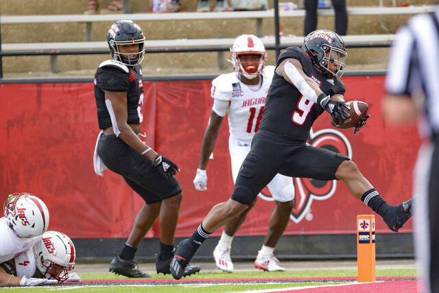 Louisiana-Lafayette running back Trey Ragas (9) scores a touchdown against South Alabama in the second half of an NCAA college football game in Lafayette, La., Saturday, Nov. 14, 2020. (AP Photo/Matthew Hinton)