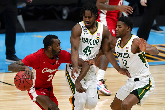 Houston guard DeJon Jarreau (3) drives around Baylor guard Davion Mitchell (45) and guard Jared Butler (12) during the first half of a men's Final Four NCAA college basketball tournament semifinal game, Saturday, April 3, 2021, at Lucas Oil Stadium in Indianapolis. (AP Photo/Michael Conroy)