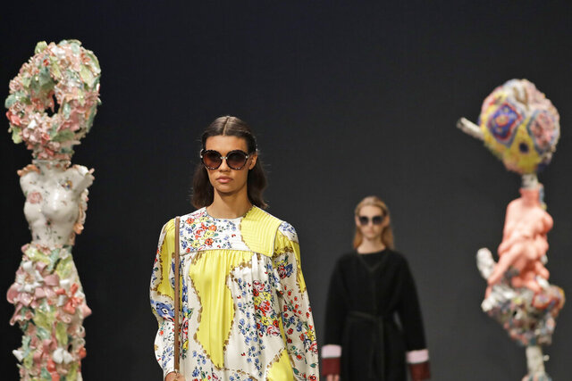 The Tory Burch collection is modeled during Fashion Week in New York, Sunday, Feb. 9, 2020. (AP Photo/Seth Wenig)