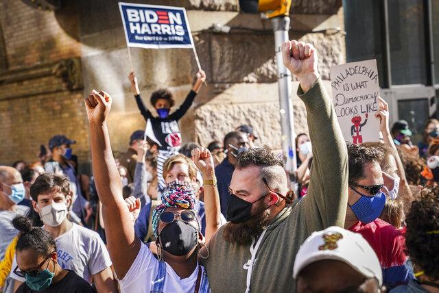 Demonstrators celebrate after the 2020 presidential election is called for President-elect Joe Biden, Saturday, Nov. 7, 2020, in Philadelphia. (AP Photo/John Minchillo)