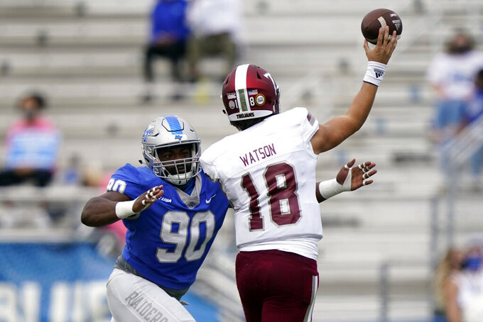 Troy quarterback Gunnar Watson (18) passes as he is pressured by Middle Tennessee defensive tackle Rakavian Poydras (90) in the first half of an NCAA college football game Saturday, Sept. 19, 2020, in Murfreesboro, Tenn. (AP Photo/Mark Humphrey)