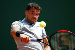 Bulgaria's Gregor Dimitrov returns the ball to Spain's Rafael Nadal during their semifinal singles match of the Monte Carlo Tennis Masters tournament in Monaco, Saturday April 21, 2018. (AP Photo/Christophe Ena)