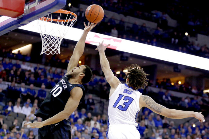 Butler's Bryce Nze (10) goes to the basket againat Creighton's Christian Bishop (13) during the first half of an NCAA college basketball game in Omaha, Neb., Sunday, Feb. 23, 2020. (AP Photo/Nati Harnik)