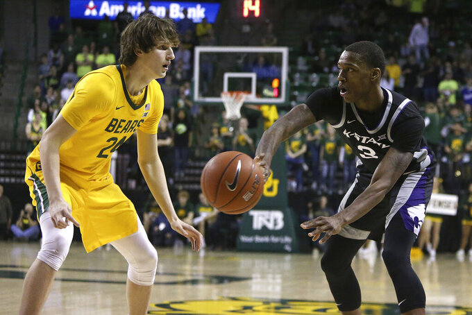 Kansas State guard DaJuan Gordon (3) passes the ball past Baylor guard Matthew Mayer (24) in the first half of an NCAA college basketball game, Tuesday, Feb. 25, 2020, in Waco, Texas. (AP Photo/ Jerry Larson)