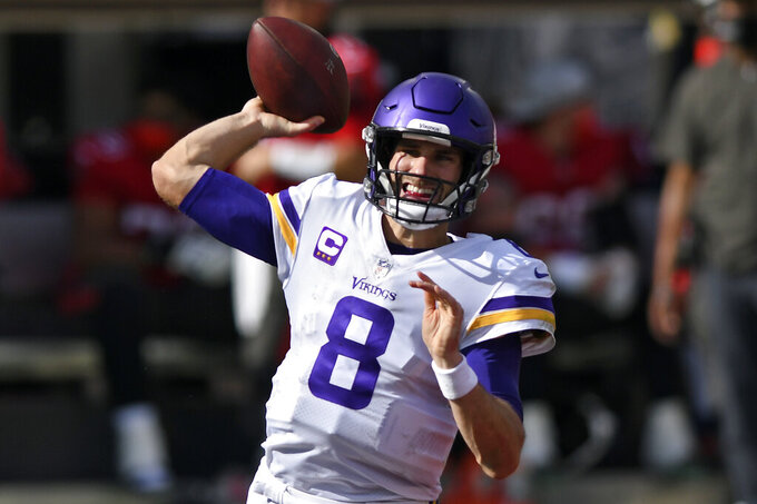 Minnesota Vikings quarterback Kirk Cousins (8) throws a pass against the Tampa Bay Buccaneers during the first half of an NFL football game Sunday, Dec. 13, 2020, in Tampa, Fla. (AP Photo/Jason Behnken)