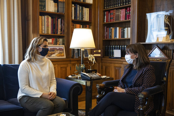 Greek President Katerina Sakellaropoulou meets Olympic sailing champion Sofia Bekatorou, left, at the Presidential Palace in Athens, Monday, Jan. 18, 2021. Bekatorou has accused an unnamed sporting official of sexually assaulting her in 1998 during preparations for the Sydney Games. Bekatorou made the allegation Thursday Jan. 14, 2021 while speaking at an online event organized by the ministry of culture and sport. (Alkis Konstantinidis /Pool via AP)