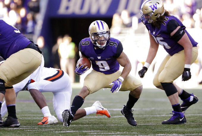 Washington's Myles Gaskin (9) rushes against Oregon State in the first half of an NCAA college football game Saturday, Nov. 17, 2018, in Seattle. (AP Photo/Elaine Thompson)