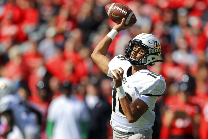 UCF quarterback Mikey Keene (16) throws a pass during the first half of an NCAA college football game against Cincinnati, Saturday, Oct. 16, 2021, in Cincinnati. (AP Photo/Aaron Doster)