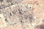 This Sunday, Sept. 15, 2019 false-color image from the European Commission's Sentinel-2 satellite shows Saudi Aramco's Abqaiq oil processing facility in Buqyaq, Saudi Arabia. Yemen's Houthi rebels claimed to have launched drone attacks on the world's largest oil processing facility in Saudi Arabia and a major oil field Saturday, sparking huge fires and halting about half of the supplies from the world's largest exporter of oil. Black char marks at the center of the facility suggest the attack struck at the heart of the processing facility (European Commission via AP)