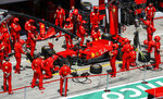 Mechanics prepare the car of Ferrari driver Sebastian Vettel prior of the Germany the Styrian Formula One Grand Prix race at the Red Bull Ring racetrack in Spielberg, Austria, Sunday, July 12, 2020. (Leonhard Foeger/Pool via AP)
