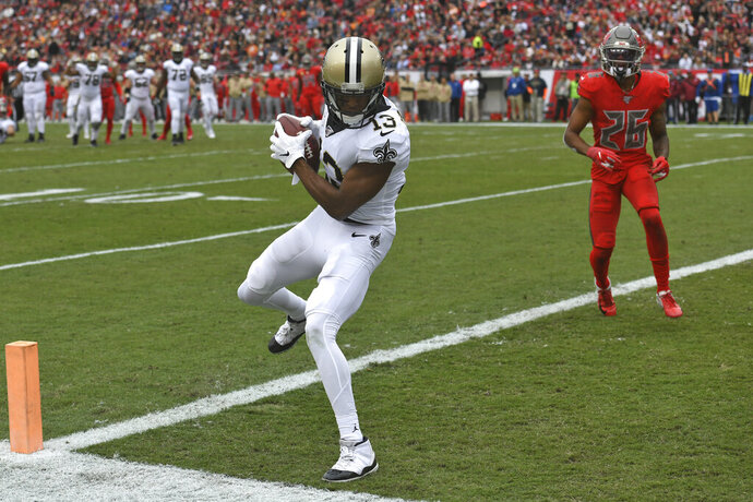 New Orleans Saints wide receiver Michael Thomas (13) beats Tampa Bay Buccaneers defensive back Sean Murphy-Bunting (26) on a 16-yard touchdown reception during the first half of an NFL football game Sunday, Nov. 17, 2019, in Tampa, Fla. (AP Photo/Jason Behnken)