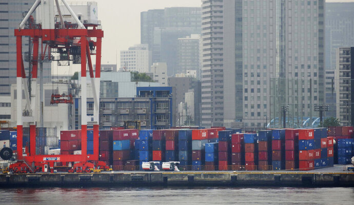 FILE - In this June 18, 2018, file photo, containers are piled up to be exported at a port in Tokyo. Japan's exports declined in March as shipments to China dropped more than 9%, pulling the nation's trade surplus sharply lower, according to the data released Wednesday, April 17, 2019. (AP Photo/Koji Sasahara, File)