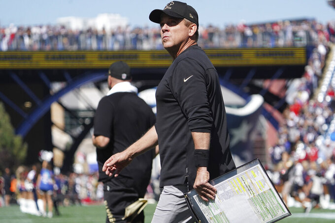 New Orleans Saints head coach Sean Payton walks toward the bench prior to the first half of an NFL football game against the New England Patriots, Sunday, Sept. 26, 2021, in Foxborough, Mass. (AP Photo/Mary Schwalm)