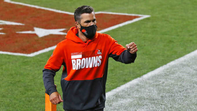 Cleveland Browns coach Kevin Stefanski pumps his fist as he runs off the field after the Browns defeated the Cincinnati Bengals 35-30 in an NFL football game Thursday, Sept. 17, 2020, in Cleveland. (AP Photo/Ron Schwane)
