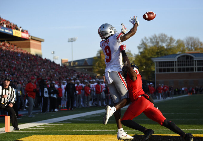 Ohio State wide receiver Binjimen Victor (9) reaches out to catch a touchdown against Maryland defensive back RaVon Davis, right, during the second half of an NCAA football game, Saturday, Nov. 17, 2018, in College Park, Md. Ohio State won 52-51 in overtime. (AP Photo/Nick Wass)