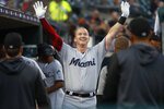 Miami Marlins' Garrett Cooper celebrates his solo home run during the sixth inning of the team's baseball game against the Detroit Tigers in Detroit, Wednesday, May 22, 2019. (AP Photo/Paul Sancya)