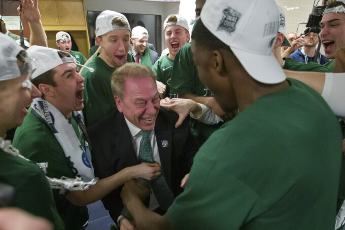 Michigan State head coach Tom Izzo, center, celebrates with his team after an NCAA men's East Regional final college basketball game against Duke in Washington, Sunday, March 31, 2019. Michigan State won 68-67. (AP Photo/Alex Brandon)