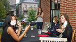 Katie Paris speaks to members of Red, Wine and Blue during a meeting, Monday, Sept. 28, 2020, in Cleveland. With perennial swing-state Ohio appearing to be a toss-up in recent polling, the roles of campaign volunteers and grassroots groups in generating enthusiasm and turning out the vote likely will be crucial in the battle for the state's 18 electoral votes. With names such as Red, Wine and Blue, Bold New Democracy and Ohio Battleground Alliance, they enable volunteers to pitch in even if they're pinned down at home with children, caregiving needs or their own health concerns. (AP Photo/Tony Dejak)