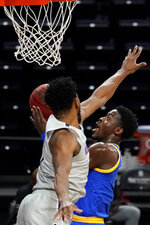 Pittsburgh guard Xavier Johnson, right, drives to the basket against Northwestern guard Anthony Gaines during the first half of an NCAA college basketball game in Evanston, Ill., Wednesday, Dec. 9, 2020. (AP Photo/Nam Y. Huh)