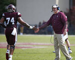 File-This April 21, 2018, file photo shows Maroon head coach Joe Moorhead congratulating Maroon offensive lineman Elgton Jenkins (74) for a successful series against the White squad during the second half of Mississippi State's Maroon and White spring NCAA college football game, in Starkville, Miss. Multi-tempo has replaced up-tempo for a lot of college offenses. Moorhead, who was offensive coordinator at Penn State the last two seasons, said his offense mostly operates at three speeds.