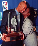 FILE - In this May 26, 1999, file photo, Toronto Raptors Vince Carter, left, gets a kiss from his mother Michelle Robinson-Carter after receiving the NBA Rookie of the Year Award during a news conference in Toronto. Carter made his retirement official Thursday, June 25, 2020, announcing on his podcast that his 22-year NBA career has come to an end. The announcement was largely a formality, since the 43-year-old Carter had said many times over the course of this season that this would be his last in the NBA. His 22 seasons are the most in league history, and he became the first NBA player to appear in four different decades. (AP Photo/Kevin Frayer, File)