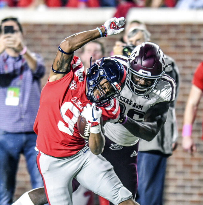 Mississippi running back Jerrion Ealy (9) slips the tackle attempt by Texas A&M defensive back Demani Richardson (26) during the first half of an NCAA college football game, Saturday, Oct. 19, 2019 in Oxford, Miss. (Bruce Newman/The Oxford Eagle via AP)