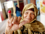 An Egyptian voter displays her inked finger after she cast her ballot on constitutional amendments during the second day of three-day voting at polling station in Cairo, Egypt, Sunday, April 21, 2019. Egyptians are voting on constitutional amendments that would allow President Abdel-Fattah el-Sissi to stay in power until 2030.(AP Photo/Amr Nabil)