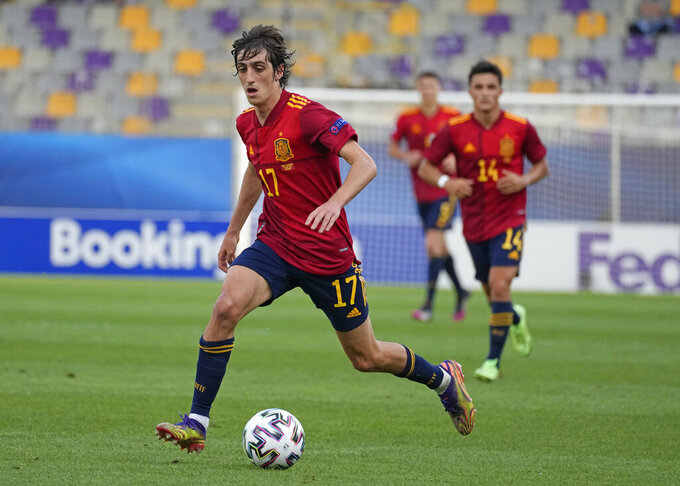 Spain's Bryan Gil runs with the ball during the Euro U21 semifinal soccer match between Spain and Portugal in Maribor, Slovenia, Thursday, June 3, 2021. (AP Photo/Darko Bandic)
