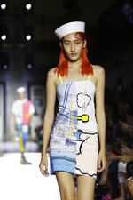A model wears a creation as part of the Benetton Spring-Summer 2020 collection, unveiled during the fashion week, in Milan, Italy, Tuesday, Sept. 17, 2019. (AP Photo/Luca Bruno)