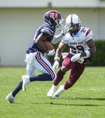 Jackson State David Arrington IV tries to get past Alabama A&M's Trenton McGhee during an NCAA college football game, Saturday, April 10, 2021, at Veterans Memorial Stadium in Jackson, Miss. (Eric Shelton/The Clarion-Ledger via AP)