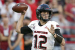 Northern Illinois quarterback Ross Bowers (12) throws a pass during the first half of an NCAA college football game against Nebraska in Lincoln, Neb., Saturday, Sept. 14, 2019. (AP Photo/Nati Harnik)