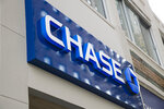 FILE- This Nov. 29, 2018, file photo shows a Chase bank location in Philadelphia. The Federal Reserve said on Thursday, June 25, 2020, a worst-case scenario for the U.S. economy ravaged by the coronavirus pandemic would cause nation's 34 largest banks to collectively lose roughly $700 billion. To bolster the banks ahead such a potentially damaging recession, the Fed ordered the banks to suspend stock buybacks and dividend payouts until Sept. 30. (AP Photo/Matt Rourke, File)