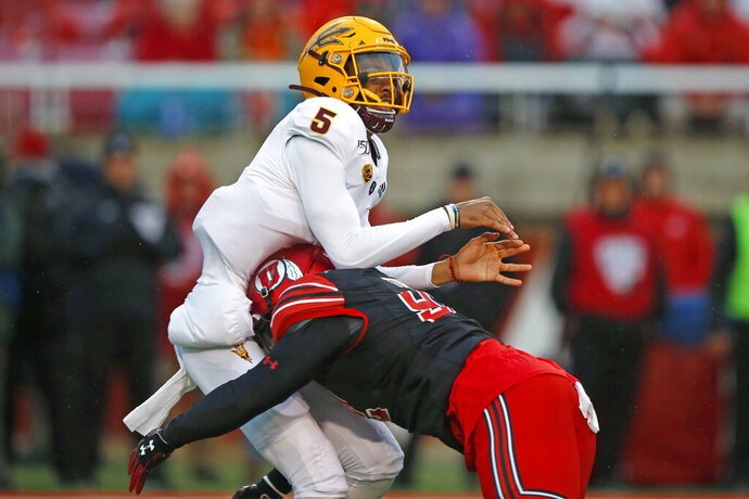 Arizona State quarterback Jayden Daniels (5) takes a hit from Utah defensive end Maxs Tupai (92) during the first half of an NCAA college football game Saturday, Oct. 19, 2019, in Salt Lake City. (AP Photo/Rick Bowmer)