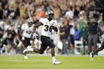 Central Florida's Greg McCrae breaks away to score a touchdown against South Florida during the first half of an NCAA college football game Friday, Nov. 23, 2018, in Tampa, Fla. (AP Photo/Mike Carlson)