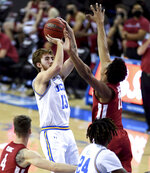 Jake Kyman (13) of the UCLA Bruins shoots a three pointer against the Washington State Cougars in the first half of a NCAA basketball game at Pauley Pavilion on the campus of UCLA in Westwood on Thursday, Jan. 14, 2021. (Keith Birmingham/The Orange County Register via AP)